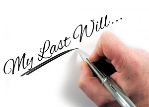 Someone writing 'My Last Will...'